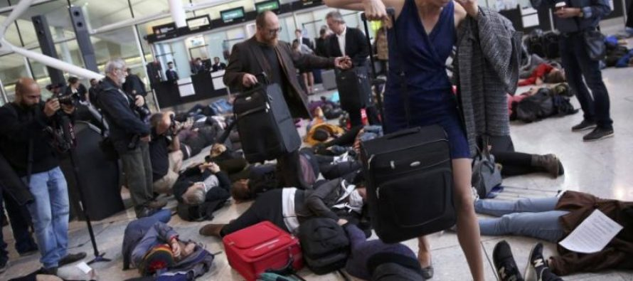 Protesters hold 'die-in' at Heathrow against airport expansion
