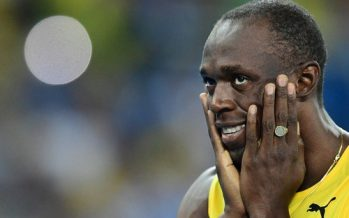 Bolt wins third Olympic 200m title