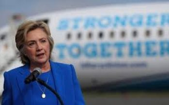 Clinton to travel Sunday to protest-hit Charlotte: campaign