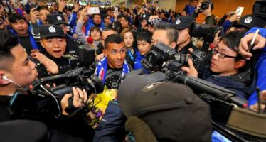 Tevez mobbed after touching down in Shanghai