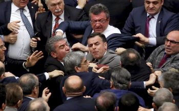 Turkish lawmakers throw chairs as parliament approves more articles in a bill boosting Erdogan's powers